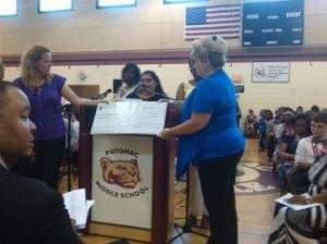 This picture was taken when Michelle (treasurer), Johana (president) and Jerri (secretary) presented the middle school principal with a check for the funds raised with the Popcorn Palace fundraiser.
