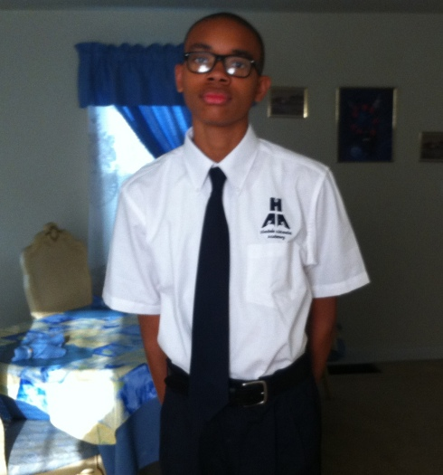 A photo of Theda Robinson's son, in his new school uniform.
